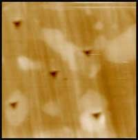 Selective testing of individual phases in a multi-phase material