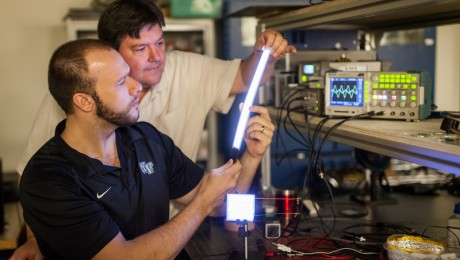 David Carroll in the lab with graduate student Greg Smith and their new FIPEL lighting technology.