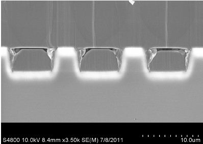 SEM Image of the structures - Vertical lines are steps due to cleavage with a higher line density in regions of direct contact between GaN and sapphire.