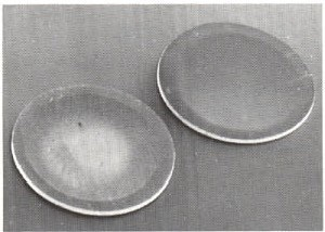 SEM image of a 316 stainless steel TEM specimen disc after grinding (left) and polishing (right) with CBN.
