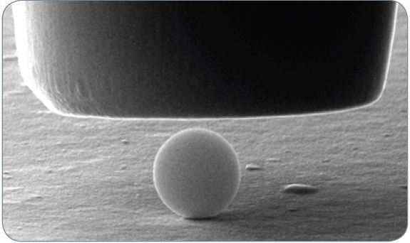 A 1 µm silica particle prior to compression with a 5 µm flat punch probe.