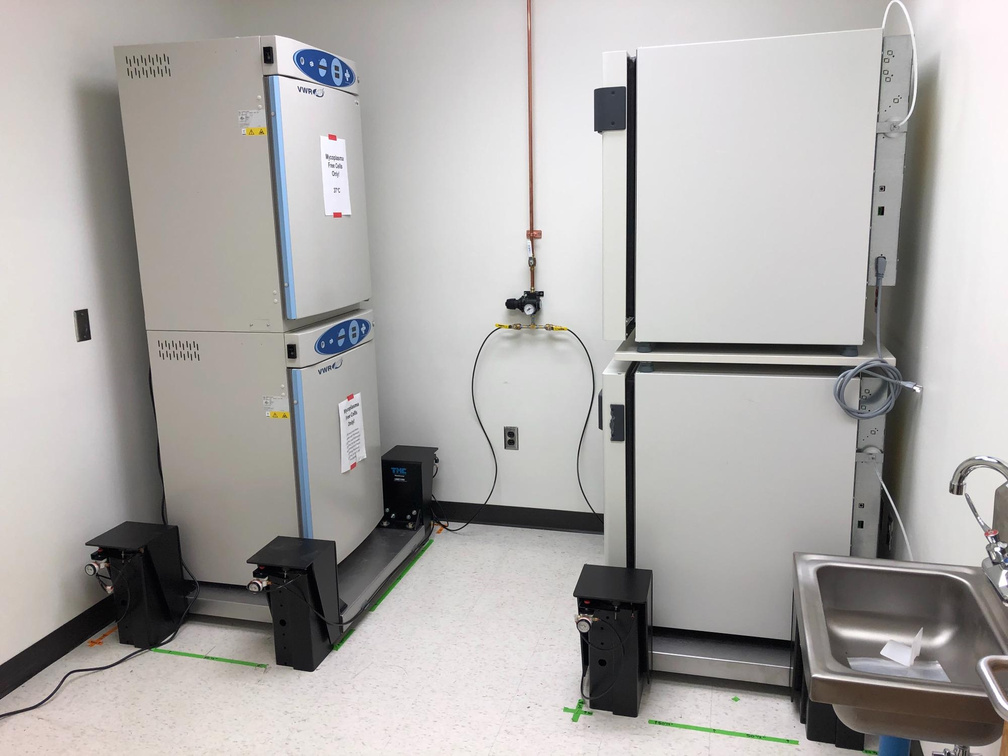 Incubators stacked on TMC MaxDamp vibration isolation platforms.